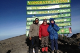 Jenny in Equal Standing (Samastitihi), along with her husband, Ian Hatter, and their Assistant Guide, Raymond Stephen Kayama, on the summit of Mount Kilimanjaro (19,341 feet or 5895 metres above sea level) in Tanzania, Africa, January 26, 2013, 7:30am.  (Photo by Willibard Peter, Chief Guide, Zara Tours).