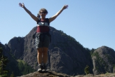 Jenny in Mountain Pose with Extended Hands (Utthita Hasta in Tadasana), also called Upward Salute (Urdhva Hastasana) atop Mount Cokely, Vancouver Island, B.C.