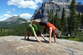 Ian and Jenny in Double Downward Facing Dog (Yugalaka Adho Mukha Svanasana) near the Giant Steps along the Paradise Valley Trail below Mount Temple, in Banff National Park, Alberta (Photo by Gwen Smiley).