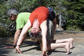 Ian and Jenny in Massage Table Two in Paradise Valley, Banff National Park, Alberta.  Ian then goes into Cat Pose (Marjaryasana), tucking his tailbone and arching his back, which provides a major front body and back stretch for Jenny (Photo by Gwen Smiley).