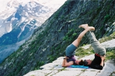 Ian and Jenny in Double Shoulderstand Pose (Yugalaka Sarvangasana) on Abbott Ridge in Glacier National Park, B.C. (Photo by Erin Minor).