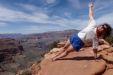Jenny in Side Plank Pose (Vasisthasana) looking up, along the Bright Angel Trail, Grand Canyon National Park, Arizona (Photo by Ian Hatter).