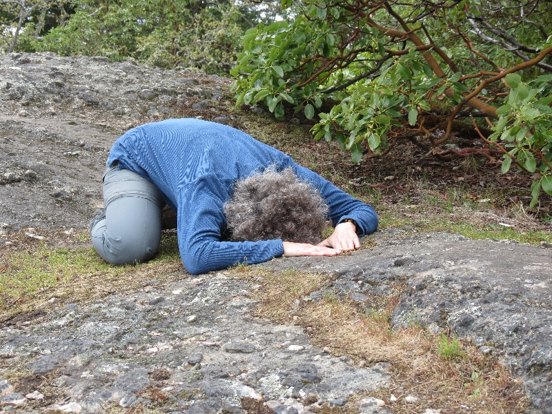 Jenny in a Restorative Child's Pose (Balasana) near the summit of Mount Tzouhalem, Vancouver Island, B.C. This version helps to open the hips and relax the upper back, shoulders, neck and arms (Photo by Ian Hatter).