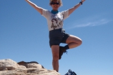 Jenny in Tree Pose (Vrikshasana) with tree branches (arms) extended atop the final peak along the Navajo Knobs Trail, Capitol Reef National Park, Utah (Photo by Ian Hatter).