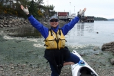 Jenny in Tree Pose (Vrikshasana) with tree branches (arms) extended before a kayak trip from Sidney, Vancouver Island over to Portland (formerly Princess Margaret) Island in Gulf Islands National Park, B.C. (Photo by Ian Hatter).