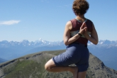 Jenny in Tree Pose (Vrikshasana) with arms in reverse prayer (Pashchima Namaskarasana), which really stretches the muscles of the wrists and forearms, on the highest of the Bald Hills in Jasper National Park, Alberta (Photo by Ian Hatter).