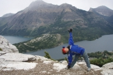 Jenny in Extended Triangle Pose (Utthita Trikonasana), gaze up, on top of the Bear's Hump in Waterton Lakes National Park, Alberta (Photo by Ian Hatter).