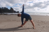 Jenny in Extended Triangle Pose (Utthita Trikonasana), gaze up, at Second Beach, Olympic National Park, Washington State (Photo by Ian Hatter).