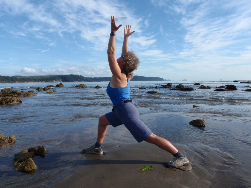 Jenny Feick in Warrior One Pose (Virabhadrasana I) at Sand Point Beach, Olympic National Park, Washington State (Photo by Ian Hatter)