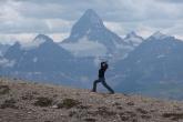 Jenny in Warrior One Pose (Virabhadrasana I) on Windy Ridge, Mount Assiniboine Provincial Park, B.C. (Photo by Ian Hatter).