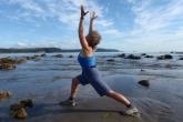 Jenny Feick in Warrior One Pose (Virabhadrasana I) at Sand Point Beach, Olympic National Park, Washington State (Photo by Ian Hatter)