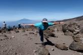 Jenny in Warrior Three Pose (Virabhadrasana III) at 15,260 feet above sea level above Barafu Camp on Mount Kilimanjaro, Tanzania, Africa (Photo by Ian Hatter).