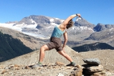 Jenny in Exalted Warrior (Viparita Virabhadrasana) along the Iceline Trail in Yoho National Park, B.C. (Photo by Ian Hatter).