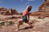 Jenny in Exalted Warrior (Viparita Virabhadrasana) in the Needles area of Canyonlands National Park, Utah (Photo by Ian Hatter).