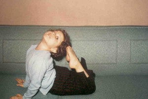 Jenny practising yoga at her young age