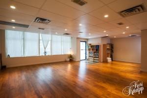 The yoga classroom at Balu Yoga & Wellness Studio is spacious and inviting.